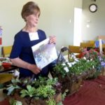 #Sylvia Tweten demonstrating hanging flower baskets 7-12-16 IMG_0144
